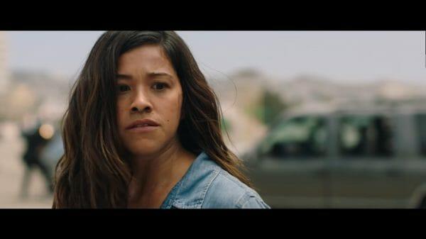 Gloria (Gina Rodriguez) contemplating whether to save Lino.