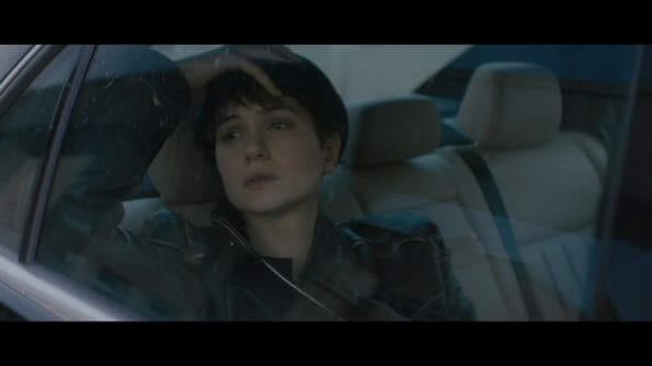 Katherine (Katherine Waterston) in transit somewhere.
