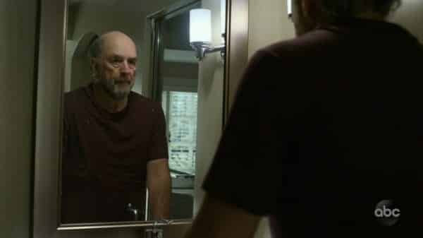 Dr. Glassman looking in a mirror.