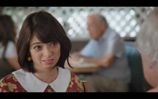 Jeannie (Kate Micucci) making a face while talking to her grandpa.