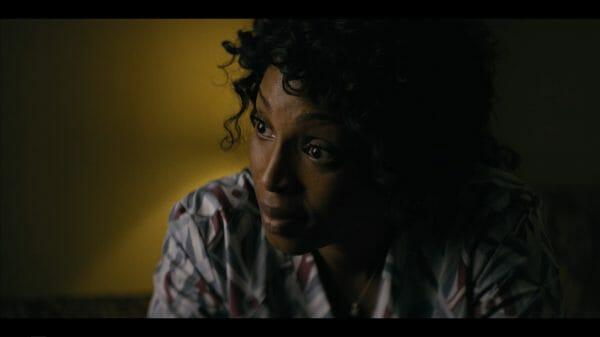 Gail (Lisa Berry) talking to Wayne.