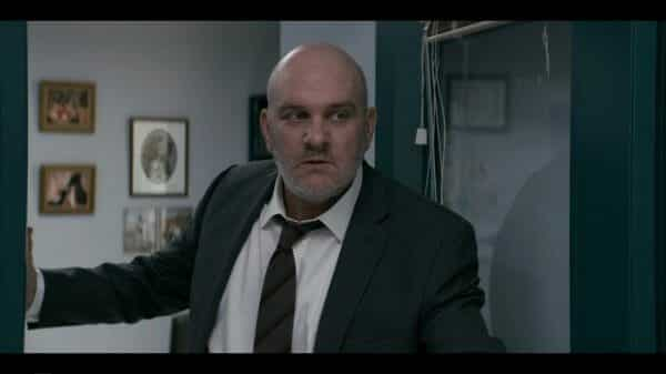 Principal Cole (Mike O'Malley) at his office.