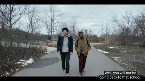 Wayne and Orlando (Joshua J. Williams) walking together.