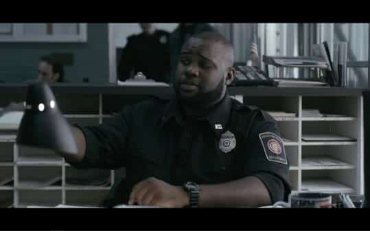 Jay (James Earl) at his desk in the precinct.