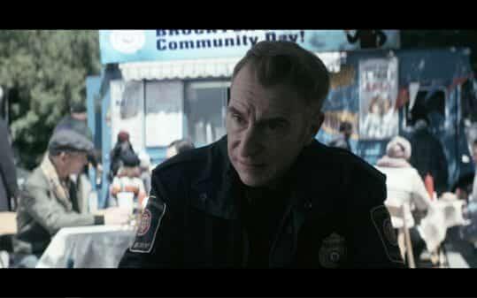 Sargent Geller (Stephen Kearin) talking to Bobby.