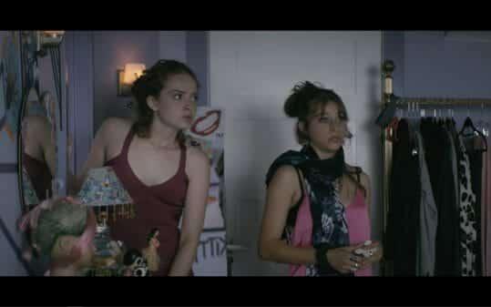 Jenny (Zoe De Grand Maison) and Trish (Odessa Adlon) being silly.