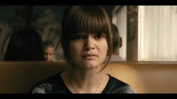 Del's face after realizing what Wayne did for her mom and her.