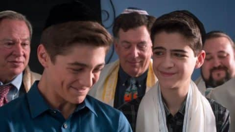 Jonah and Cyrus praying during Minyan.