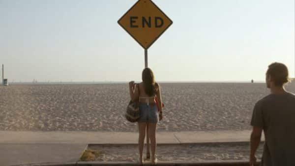 Amanda looking at a End sign.