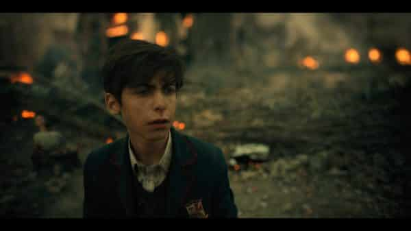 Number 5 (Aidan Gallagher) in the future, after the world is destroyed.
