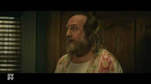 Sandy (Brian Posehn) still in Shabnam's house.