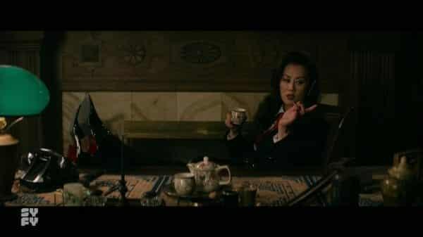 Gao (Olivia Cheng) making herself comfortable at Master Lin's desk.