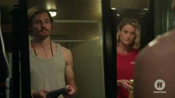 Dennis (Josh Pence) and Stef (Teri Polo) talking in the bathroom.
