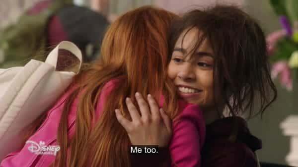 Athena (Cirara Riley Wilson) hugging Kim.