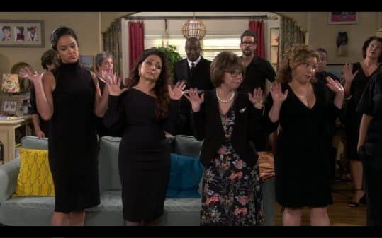 Estrellia (Melissa Fumero), Mirtha (Gloria Estefan), Lydia, and Penelope raising their hands up.