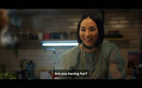 Maxine (Greta Lee) asking Nadia if she is enjoying her birthday party - that Maxine arranged.