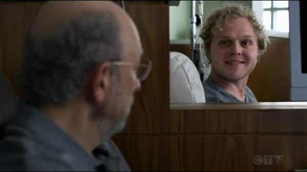 Larry (Joe Adler) smiling at Dr. Glassman.