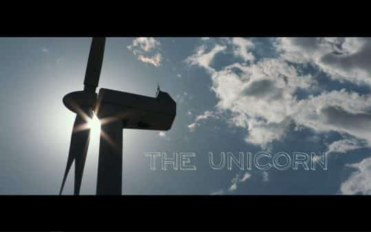 The Unicorn (2019) - Colorful Title Card featuring a windmill.