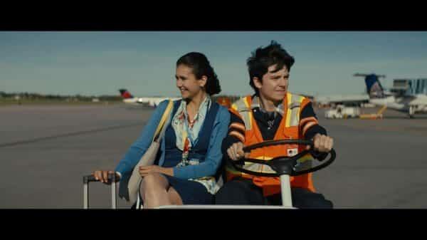 Izzy (Nina Dobrev) and Calvin (Asa Butterfield) as Calvin takes her to her plane.