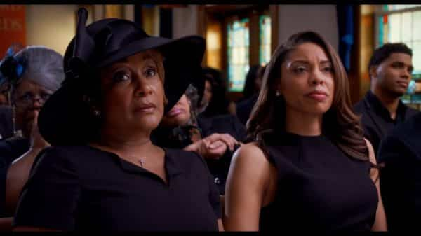 Vianne (Jen Harper) and Sylvia (Ciera Payton) during Anthony's funeral.