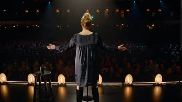 Amy Schumer with arms out and stretched.