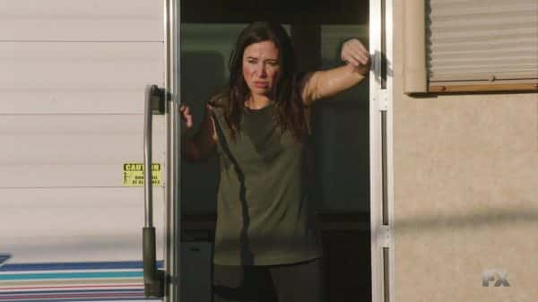 Sam getting out of her muggy trailer.