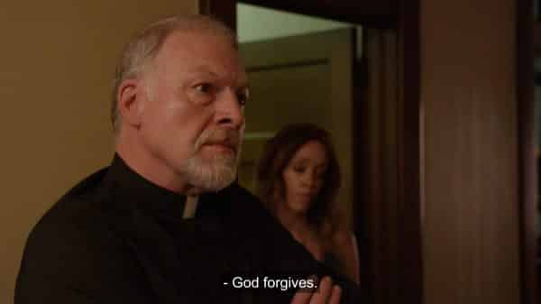 Father Evans (Todd Lewis) noting God forgives.
