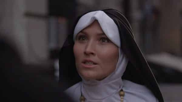 Sister Rogers (Stefaniya Makarova) threatening Kiki.
