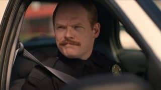 Officer Hamill (Brent Wezner) driving shotgun.