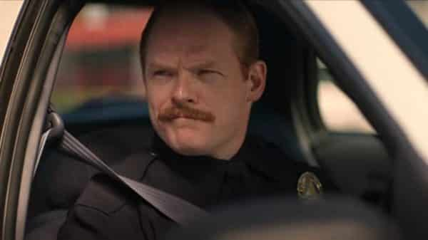 Officer Hamill (Brent Wezner) driving shotgun.