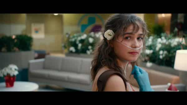 Stella (Haley Lu Richardson) with a flower in her hair.