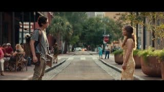 Will (Cole Sprouse) and Stella (Haley Lu Richardson) standing on a street looking at one another.