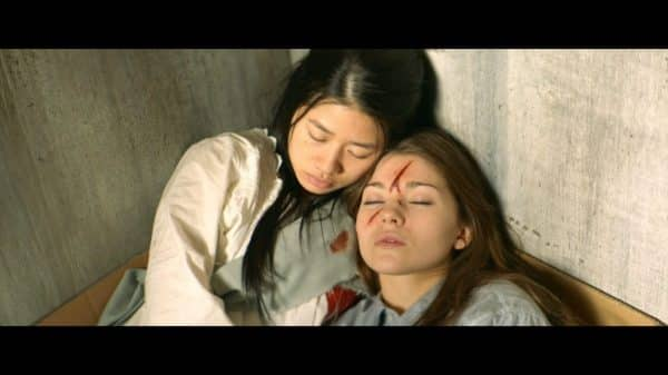 Sophia (Celina Martin) and Vivien (Katie Douglas) when discovered by police.
