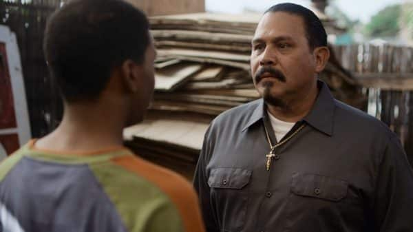 Chivo (Emilio Rivera) as Jamal tries to get flowers for Olivia's quince.