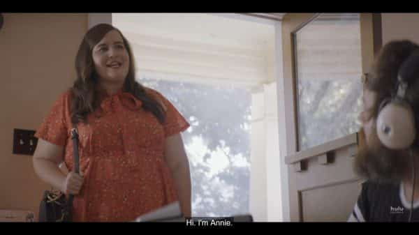 Annie (Aidy Bryant) introducing herself to Ryan's friends.