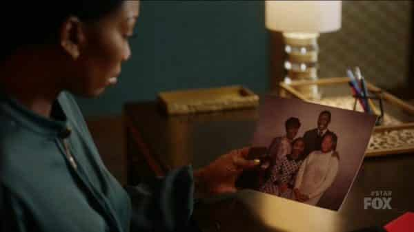 Cassie looking at a old family picture.