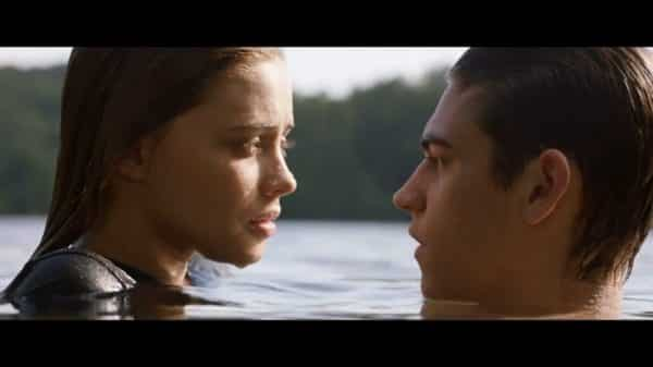 Tessa (Josephine Langford) and Hardin (Hero Fiennes Tiffin) in a lake somewhere.