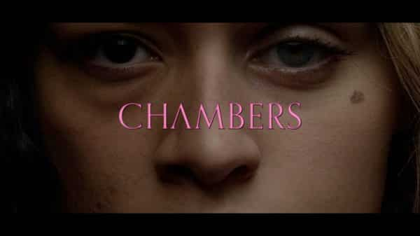 Half of Rebecca's face and half of Sasha's as the Chambers title card.