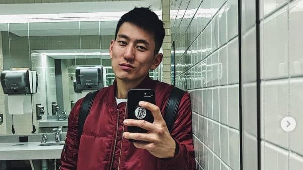 Image of Jake Choi taking a selfie in the bathroom.