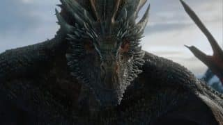 One of Daenerys' dragons looking on as she and Jon make out.
