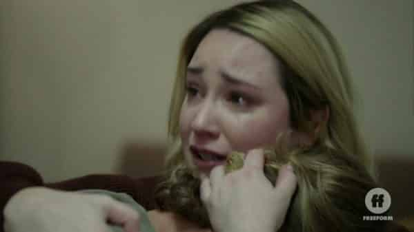 Dennis crying on Davia's shoulder.