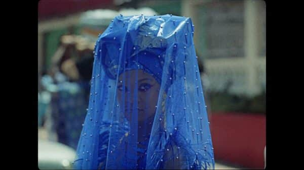 Kofi (Rihanna) in a blue veil towards the end of the movie.