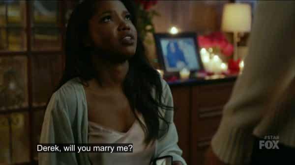Alex proposing to Derek.