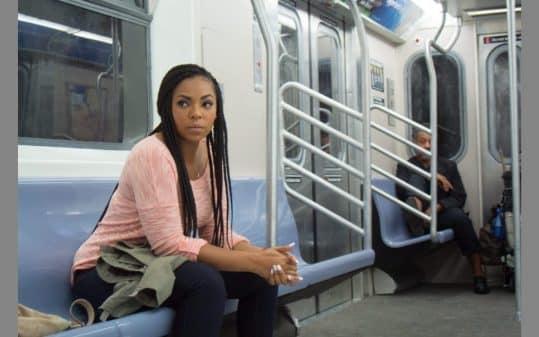 Eve (Ashanti) in the movie Stuck.
