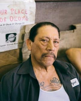 Miguel (Danny Trejo) taking a picture with a stern face.