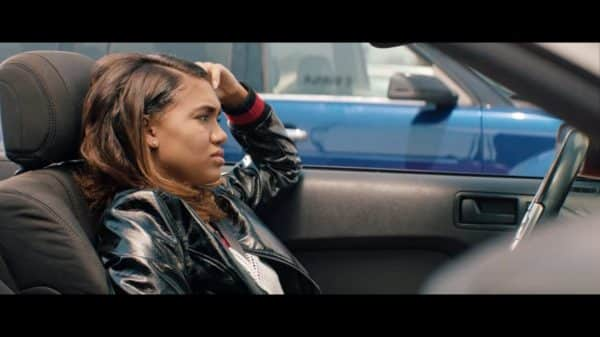 Gina (Paige Hurd) trying to figure how to get at Lisa for taking her man.