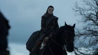 Sansa on a horse, following The Hound.