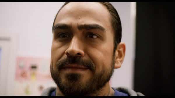 Barry (Anthony L. Fernandez) looking upset.