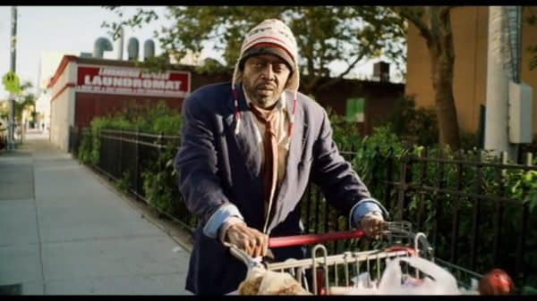 Crackhead Carl (Donnell Rawlings) walking with his cart.