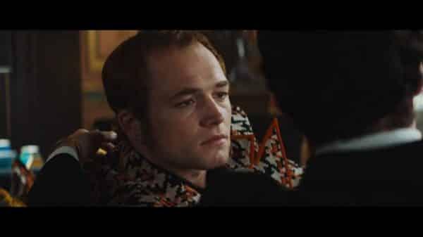 Elton John (Taron Egerton) talking to John (Richard Madden)